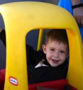 Three year old enjoying his Cozy Coupe